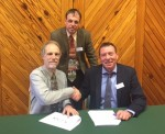 Peter Hinton and Michael MacDonagh sign the MoU